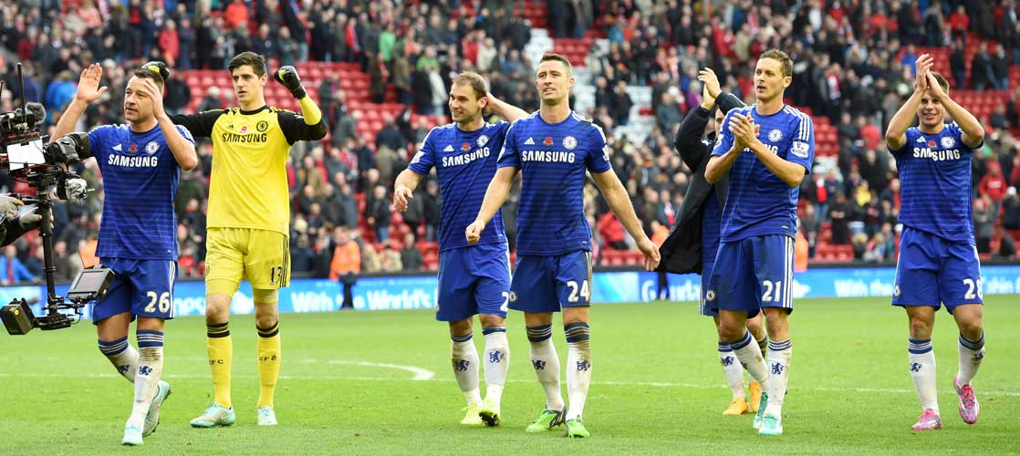 Chelsea players applaud the Chelsea supporters